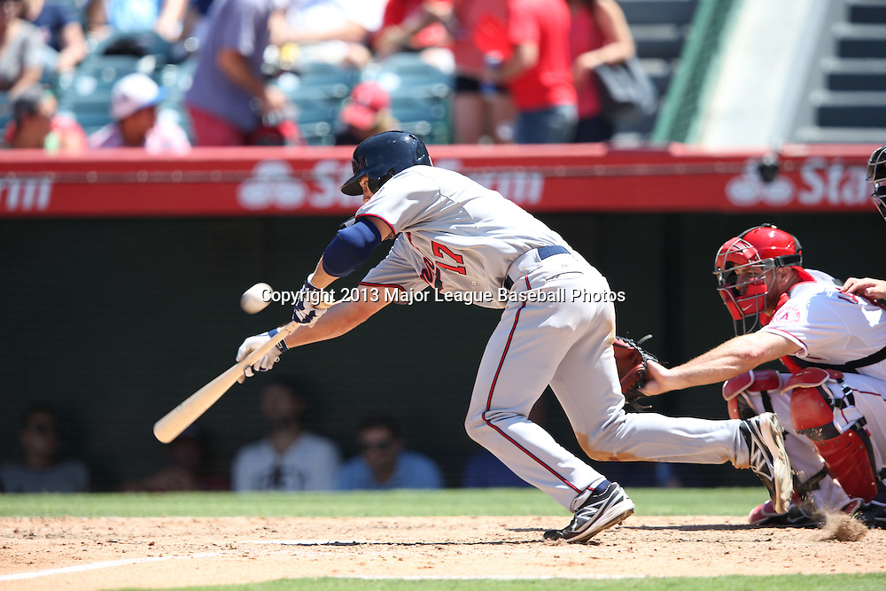 ANAHEIM, CA - JULY 24:  Doug Bernier #17 of the Minnesota Twins attempts a bunt during the game against the Los Angeles Angels of Anaheim on Wednesday, July 24, 2013 at Angel Stadium in Anaheim, California. The Angels won the game in a 1-0 shutout. (Photo by Paul Spinelli/MLB Photos via Getty Images) *** Local Caption *** Doug Bernier