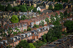 © Licensed to London News Pictures. 14/06/2017. London, UK. A view over the rooftops of Queens park, north of Notting Hill in west London. Photo credit: Ben Cawthra/LNP