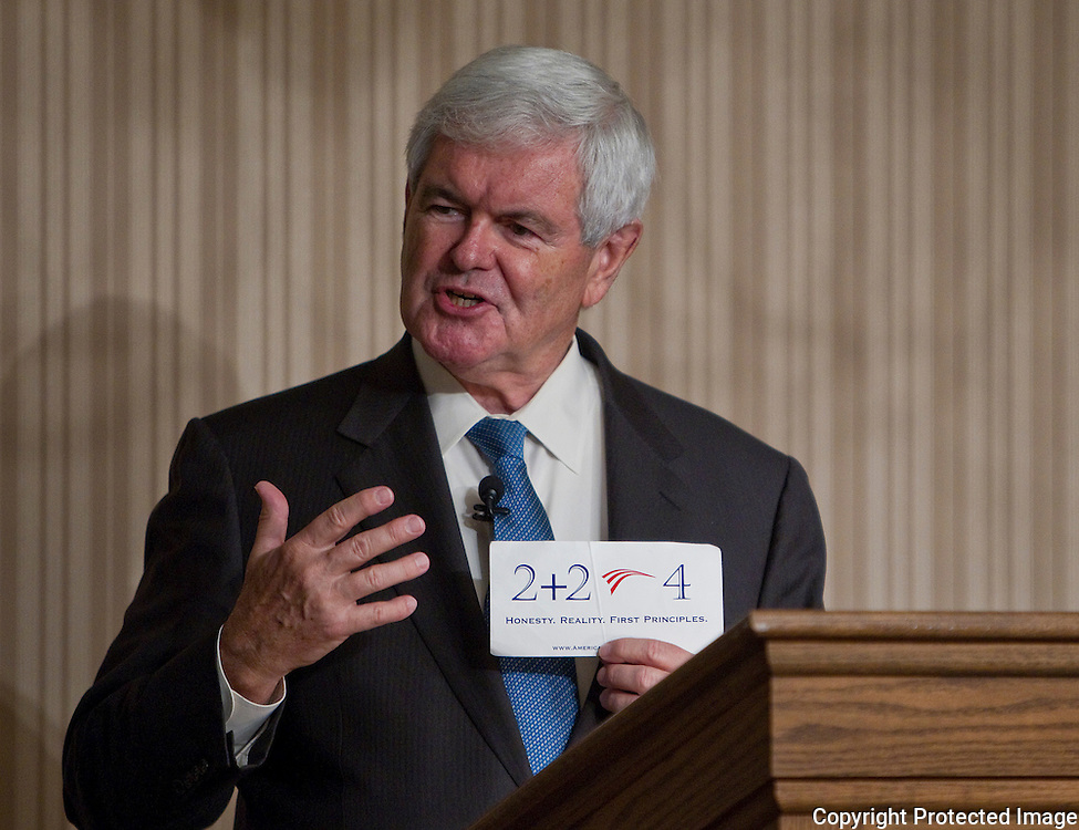 Former House Speaker Newt Gingrich holds up a card he carries with him as he speaks to area business leaders at the Pella Opera House in Pella, Iowa on Thursday September 9, 2010. (Stephen Mally for The New York Times)