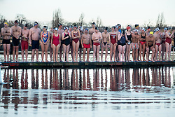 Serpentine Christmas Day Swimming. Members of the Serpentine Swimming club prepare to take part in the annual Peter Pan Cup - Christmas Day race in the  Serpentine lake.  The swimmers compete in a 100 yard swimming race which has taken place on Christmas Day every year since 1864 The Serpentine Lake, London, United Kingdom. Wednesday, 25th December 2013. Picture by Peter Kollanyi / i-Images