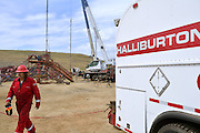 Halliburton crew fracking a Statoil-owned oil well a few miles east of Williston ND.<br /> Halliburton is one of the bigger players in the oil boom.<br /> North Dakota oil boom. Based around the town of Williston, hydraulic fracturing, also known as 'fracking' has enabled a vast reserve of previously unobtainable oil to be accessed.