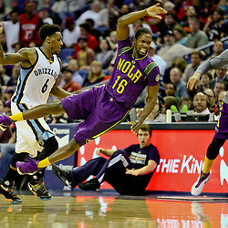 Feb 1, 2016; New Orleans, LA, USA; \New Orleans Pelicans guard Toney Douglas (16) is fouled by Memphis Grizzlies guard Mario Chalmers (6) while scrambling for a loose ball as forward Anthony Davis (background) reacts during the second half of a game at the Smoothie King Center. The Grizzlies defeated the Pelicans 110-95. Mandatory Credit: Derick E. Hingle-USA TODAY Sports