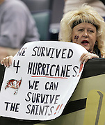 NEW ORLEANS - OCTOBER 10:  A Tampa Bay Buccaneers fan with a Florida hurricane sign supports her team against the New Orleans Saints at the Louisiana Superdome on October 10, 2004 in New Orleans, Louisiana. The Bucs defeated the Saints 20-17. ©Paul Anthony Spinelli *** Local Caption *** Hurricane Sign