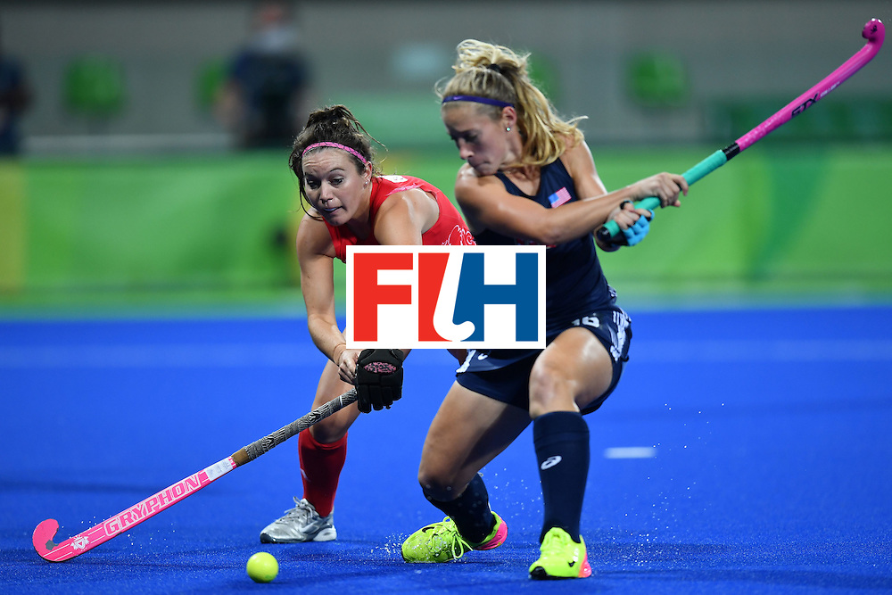 USA's Katie Bam (R) and Britain's Laura Unsworth vie during the women's field hockey Britain vs the USA match of the Rio 2016 Olympics Games at the Olympic Hockey Centre in Rio de Janeiro on August, 13 2016. / AFP / MANAN VATSYAYANA        (Photo credit should read MANAN VATSYAYANA/AFP/Getty Images)
