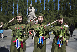 May 9, 2018 - Berlin, Germany - Luisa, Julia and Alina from Eberswalde pose for a picture on the 73rd anniversary of the victory of the Soviet Red Army over Nazi Germany at the Soviet World War II cemetery and memorial in Treptow on May 9, 2018 in Berlin, Germany. (The mother of the girls agreed to the publication of the picture) (Credit Image: © Emmanuele Contini/NurPhoto via ZUMA Press)