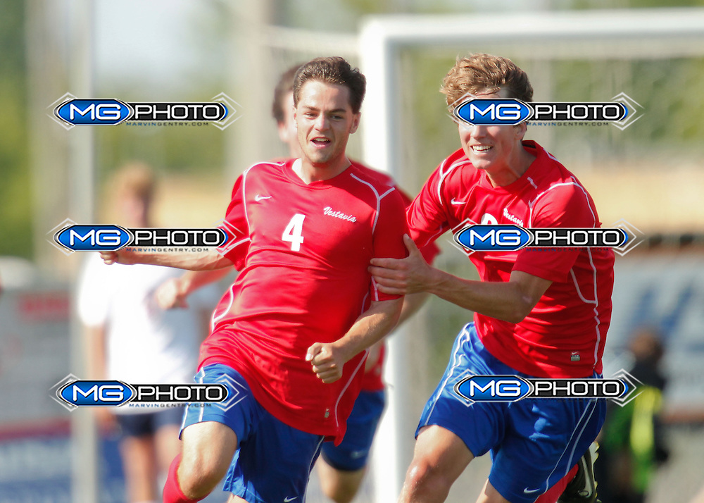 May 10, 2014; Huntsville, AL, USA; Vestavia Nate Dauphin (4) is congratulated by teammate Matt Copeland (8) after Dauphin scored his second point of the day against Oak MOuntain during the Championship game at John Hunt Soccer Complex. Mandatory Credit: Marvin Gentry