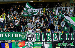 Supporters of Sporting during football match between NK Maribor and Sporting Lisbon (POR) in Group G of Group Stage of UEFA Champions League 2014/15, on September 17, 2014 in Stadium Ljudski vrt, Maribor, Slovenia. Photo by Vid Ponikvar  / Sportida.com