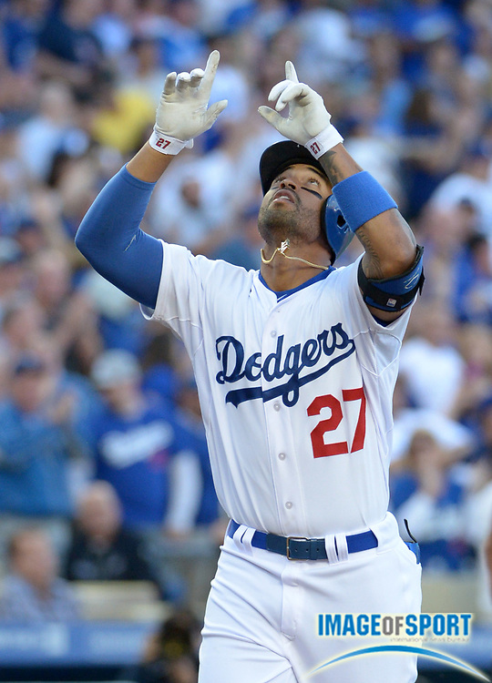 Apr 6, 2014; Los Angeles, CA, USA; Los Angeles Dodgers center fielder Matt Kemp (27) celebrates after hitting a two-run home run in the fourth inning against the San Francisco Giants at Dodger Stadium.