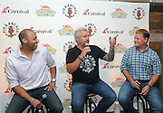 Food Network Star Guy Fieri, center, Malcolm Burn, left, Cruise Director at Carnival Cruise Line, and Eddie Allen, Vice President of Beverage Operations at Carnival Cruise Line, attend Carnival's Summertime Beer-B-Que, Wednesday, July 27, 2016, in New York.  (Diane Bondareff/ AP Images for Carnival Cruise Line)