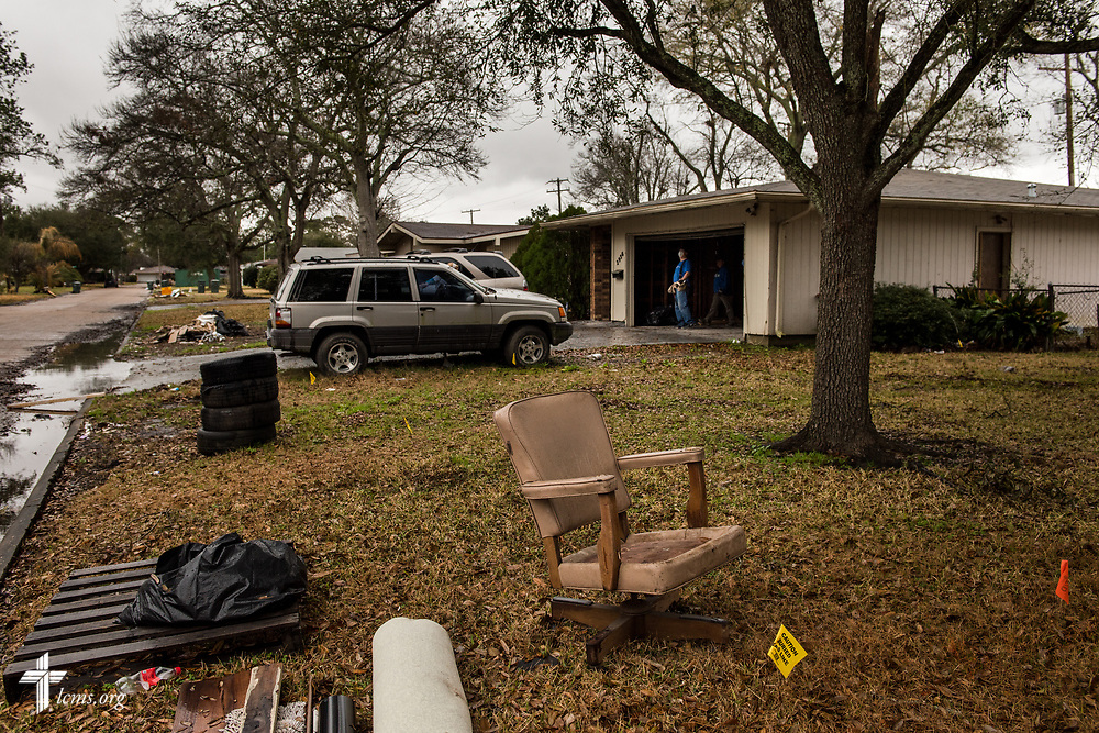 A volunteer stands in a church member's garage on Wednesday, Feb. 7, 2018, in Port Arthur, Texas. This particular neighborhood still had debris piles leftover from Hurricane Harvey, with owners living in trailers parked in front of their homes. Almost six months have passed since Hurricane Harvey devastated the area. LCMS Communications/Erik M. Lunsford