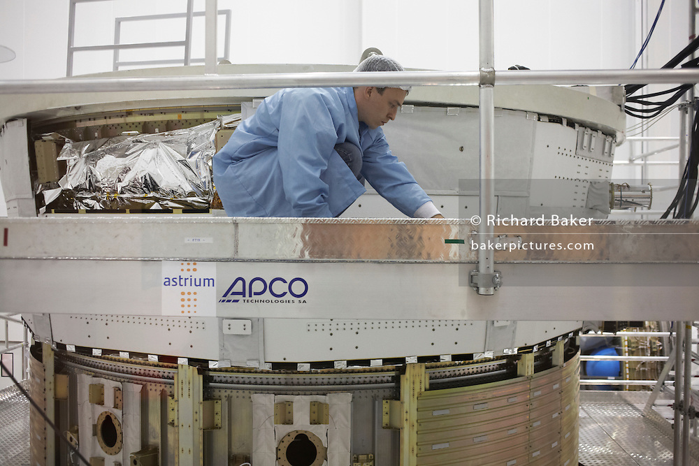Sterile technician constructs European Space Agency's Automated Transfer Vehicle (ATV) Jules Verne module at Kourou Spaceport.