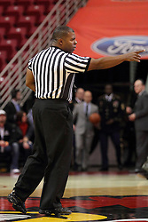29 November 2014:  Referee Winston Stith starts the clock for a time out during an NCAA men's basketball game between the Youngstown State Penguins and the Illinois State Redbirds  in Redbird Arena, Normal IL.