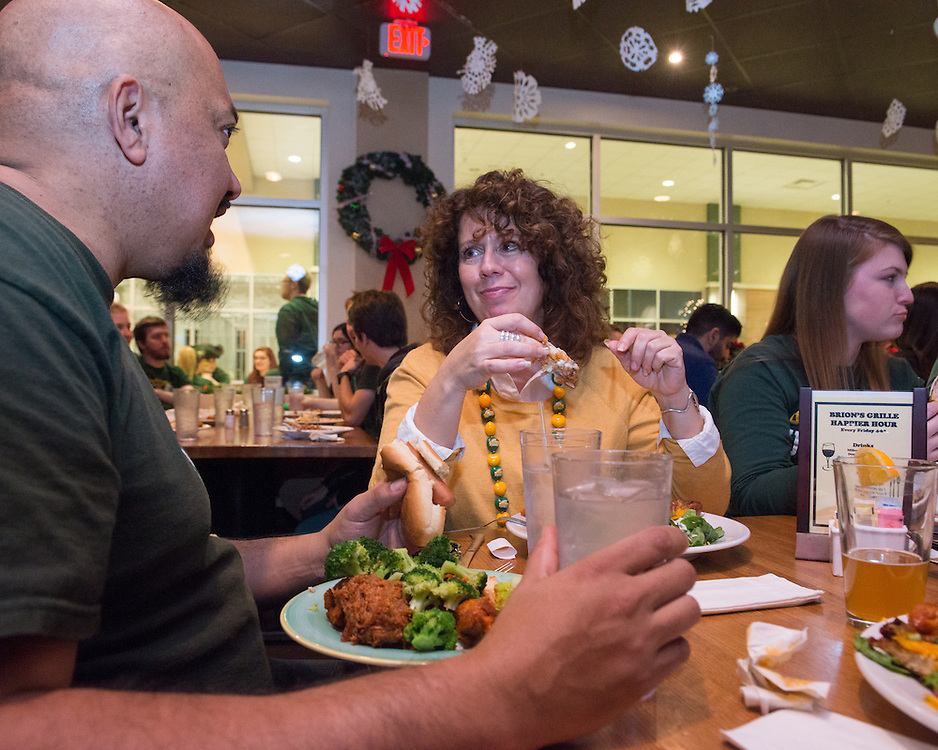 December 5, 2015 - Fairfax, VA - A day in the life of &quot;Doc Nix,&quot; aka Dr. Michael Nickens, the Director of the Athletic Bands for George Mason University.<br />  Here Coach Nix and girlfriend Lauren Wagner sit down to enjoy the after part at Brion's Grille.<br /> <br /> Photo by Susana Raab