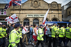 © Licensed to London News Pictures . 29/07/2017 . Rochdale , UK . Far-right street protest movement , the English Defence League ( EDL ) , hold a demonstration in Rochdale , opposed by anti-fascists , including Unite Against Fascism ( UAF ) . The EDL say they are demonstrating against the sexual grooming and abuse of English girls by Muslim men in Rochdale and against terrorism across the UK . Photo credit : Joel Goodman/LNP