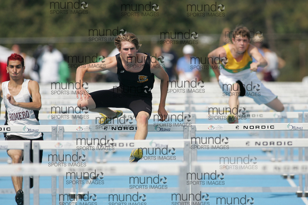 Ryan Adrian competing in heat two of the junior boys 100m hurdles qualifying round at the 2007 OFSAA track and field championships held in Ottawa.