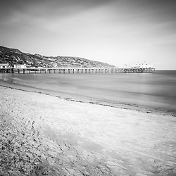 Surfrider Beach black and white photo with Malibu Pier.  Malibu is a California beach city along the Pacific Ocean in the Western United States