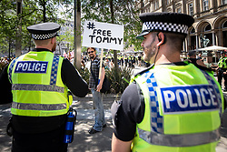 "© Licensed to London News Pictures . 07/07/2018 . Leeds , UK . A man carrying a "" FreeTommy "" placard at an anti-Islam demonstration by supporters of jailed EDL founder Tommy Robinson , including those from the "" Yorkshire Patriots "" and "" First for Britain "" , in Leeds City Centre , opposed by anti-fascists . Robinson ( real name Stephen Yaxley-Lennon ) was convicted of Contempt of Court in May 2018 after committing a second offence , whilst serving a suspended sentence for the same crime . Photo credit : Joel Goodman/LNP"