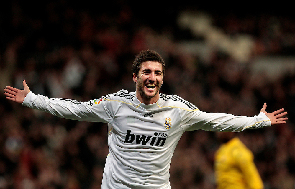 Real Madrid's Gonzalo Higuain of France celebrates after scoring against Espanyol during a Spanish La Liga soccer match at the Santiago Bernabeu stadium in Madrid, , Saturday, Feb. 6, 2010.