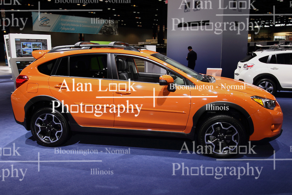 12 February 2015:  2015 SUBARU XV CROSSTREK: Subaru of America, Inc. has introduced the 2015 XV Crosstrek and XV Crosstrek Hybrid crossover models, both on display during the 107th Chicago Auto Show, Feb. 14-22, 2015. The versatile, fun-to-drive XV Crosstrek combines bold five-door design, a highly capable chassis, best-in-class fuel economy and updated infotainment features. Subaru offers the XV Crosstrek in 2.0i, 2.0i Premium and 2.0i Limited models, the latter adding additional luxury amenities and infotainment technology. Standard Symmetrical All-Wheel Drive, high ground clearance (8.7 inches), 17-inch alloy wheels and ample room for passengers and cargo make Subaru XV Crosstrek a high-capability crossover. Both the gasoline and hybrid models feature the Subaru BOXER engine and Symmetrical All-Wheel Drive standard. All gasoline models are powered by a 148-horsepower 2.0-liter BOXER engine, teamed to a five-speed manual transmission or available second- generation Lineartronic Continuously Variable Transmission (CVT). The XV Crosstrek Hybrid model's 2.0-liter Subaru BOXER engine uses a slightly higher compression ratio with the main performance boost coming from the permanent-magnet AC synchronous electric drive motor. Total hybrid system output is 160- hp, and the electric drive motor is integrated into the CVT and includes a manual mode with steering wheel paddle switches.  Among the standard features in the Premium are heated front seats, heated side mirrors and windshield wiper de-icer; a tilt/telescoping steering wheel with audio and Bluetooth control switches; power windows, door locks and side mirrors; multi-function display with fuel economy information; security system with engine immobilizer; outside temperature gauge, and carpeted floormats.<br /> <br /> First staged in 1901, the Chicago Auto Show is the largest auto show in North America and has been held more times than any other auto exposition on the continent. The 2015 show marks the 107th edition