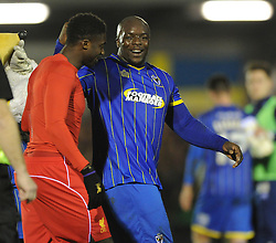 Wimbledon's Adebayo Akinfenwa shares a joke with Liverpool's Kolo Toure - Photo mandatory by-line: Dougie Allward/JMP - Mobile: 07966 386802 - 05/01/2015 - SPORT - football - London - Cherry Red Records Stadium - AFC Wimbledon v Liverpool - FA Cup - Third Round