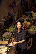 young pretty chinese produce vendor