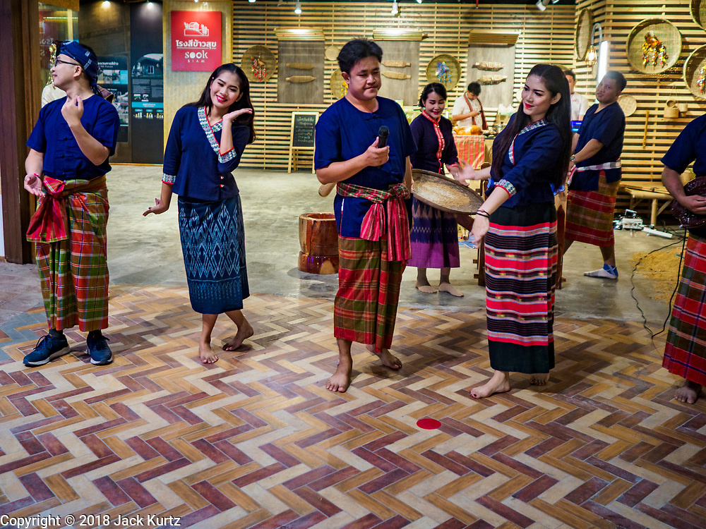 09 NOVEMBER 2018 - BANGKOK, THAILAND: Thai folk musicians from the Isan region (northeastern Thailand) perform in the traditional crafts section of ICONSIAM during the grand opening. ICONSIAM opened November 9. ICONSIAM is a mixed-use development on the Thonburi side of the Chao Phraya River. It includes two large malls, with more than 520,000 square meters of retail space, an amusement park, two residential towers and a riverside park. It is the first large scale high end development on the Thonburi side of the river and will feature the first Apple Store in Thailand and the first Takashimaya department store in Thailand.      PHOTO BY JACK KURTZ