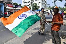 October 21, 2018 - Guwahati, Assam, India - Vendor selling Indian flag ahead of India vs West Indies one day international cricket match in Guwahati, Assam, India on Sunday, October 21, 2018. (Credit Image: © David Talukdar/NurPhoto via ZUMA Press)