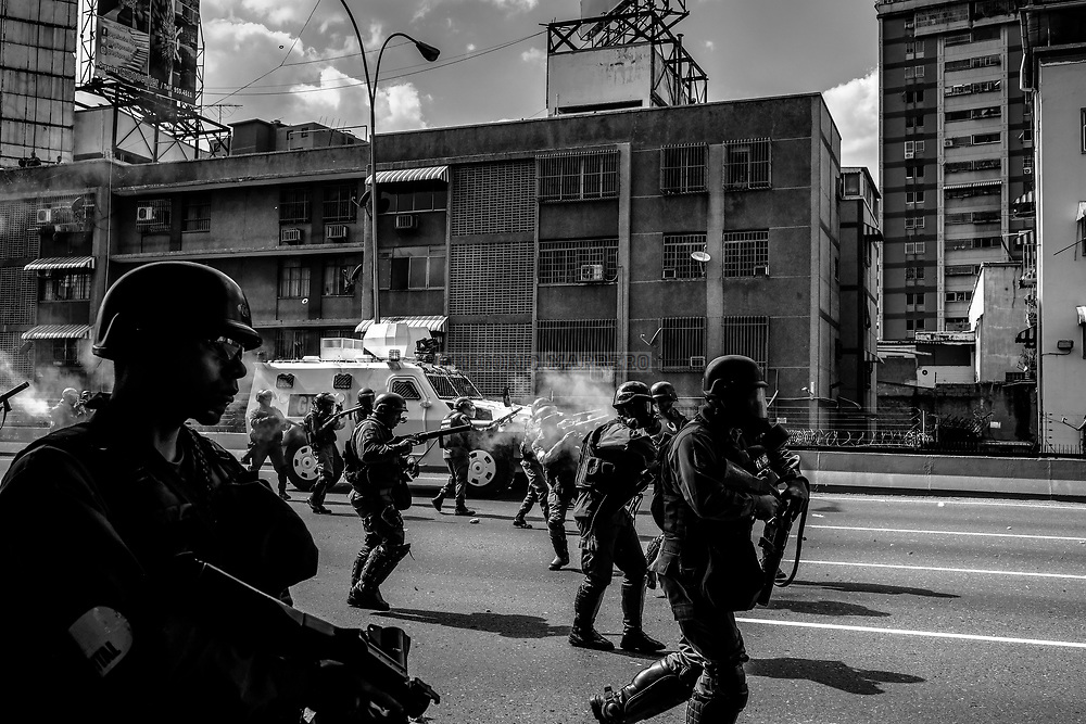 Caracas, Venezuela - 6/4/17: The National Guard represses the progress of the protest on the Francisco Fajardo highway, the principal way in Caracas. Thousands of people take the streets in the eastern neighborhoods of the city of Caracas to protest against the decision of the Supreme Court of Justice that orders the National Assembly to cease its powers and these be assumed directly by the highest court. The National Assembly was won by the Venezuelan opposition in elections held on October 15, 2015, in which the opposition coalition MUD won qualified majority of venezuelan parliament. (Photography: Gregorio Marrero)