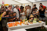Locals admire carved vegetables on a small table inside a marquee at Lambeth Country Show.
