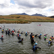 Competitors in the water at the race start during the Active Q T Ultimate Tri Series Jack's Point Triathlon, Jack's Point,  Queenstown, Otago, New Zealand. 14th January 2012. Photo Tim Clayton