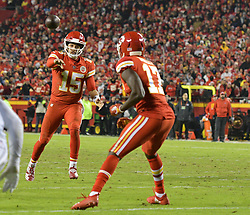 Dec 13, 2018; Kansas City, MO, USA; Kansas City Chiefs quarterback Patrick Mahomes (15) passes to wide receiver Chris Conley (17) during the second half against the Los Angeles Chargers at Arrowhead Stadium. The Chargers won 29-28. Mandatory Credit: Denny Medley-USA TODAY Sports