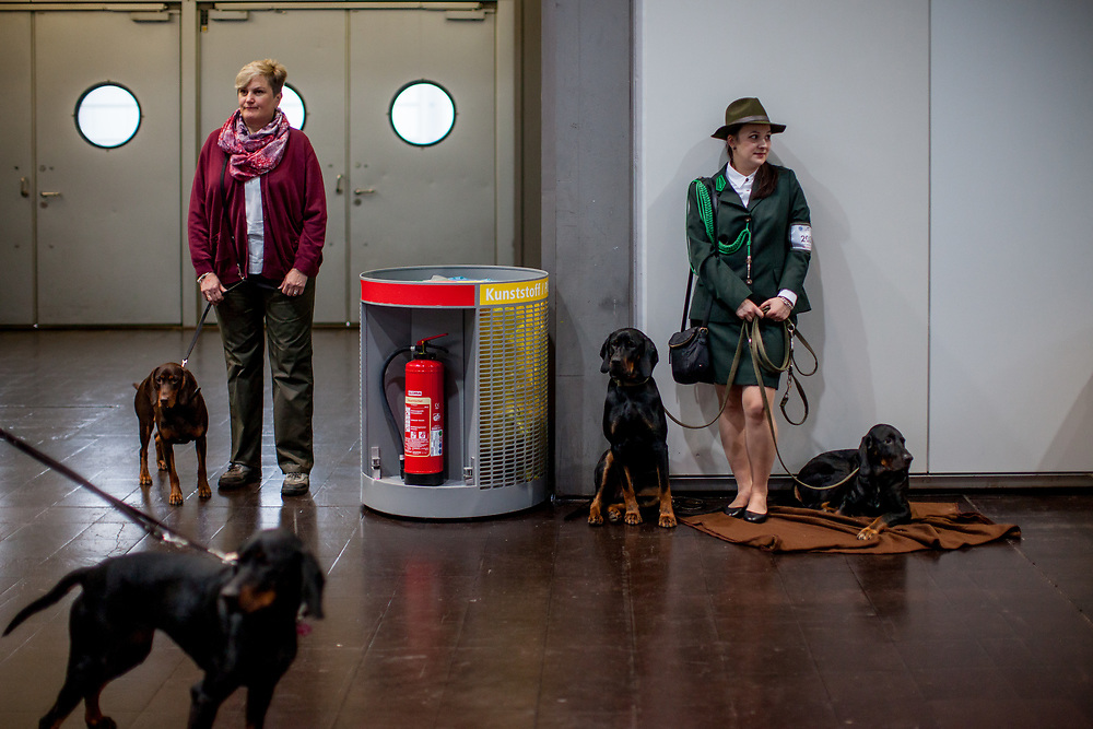 On the right Angelika Strycka a participant of the World Dog Show 2017 from Poland dressed in hunter clothes with her Polish Hunting Dogs (Balto Gorolia Klenots). Over 31,000 dogs from 73 nations will come together from 8-12 November 2017 in Leipzig for the biggest dog show in the world.