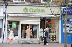 © London News Pictures. 14/07/2013. COPY AVAILABLE BELOW…. Oxfam charity shop on Orpington High Street, Kent. Orpington High street now has 12 charity shops  in one short stretch, with Cancer Research UK having two shops on different sides of the high street almost facing each other.  COPY AVAILABLE HERE:  http://tinyurl.com/nhtxtyd<br /> <br /> Photo credit :Grant Falvey/LNP