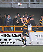 Dundee's Declan Gallagher outjumps Alloa Athletic's Andrew Kirk - Alloa Athletic v Dundee, SPFL Championship at Recreation Park, Alloa<br /> <br />  - &copy; David Young - www.davidyoungphoto.co.uk - email: davidyoungphoto@gmail.com