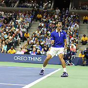 Novak Djokovic, Serbia, celebrates a break while winning the Men's Singles Final against Roger Federer, Switzerland, during the US Open Tennis Tournament, Flushing, New York, USA. 13th September 2015. Photo Tim Clayton