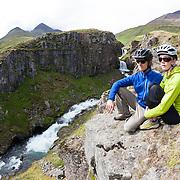 Jökull Bergmann and Sunna Björk Bragadóttir mountain biking at Þverá, Skíðadalur, North, Iceland.