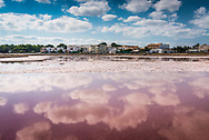 Formentera, Spain, October 2017. The Port town La Savina is surrounded by the Ses Salinas salt pans. Formentera is the smallest of Spain's Balearic islands in the Mediterranean Sea. It's reachable by ferry from its more crowded, better known island neighbor, Ibiza, and makes for a popular day-trip destination in the summertime. It's known for its clear waters and long stretches of beach backed by dunes and pine trees. Pastimes include snorkeling and sailing, with equipment rentals and boat charters available. Photo by Frits Meyst / MeystPhoto.com