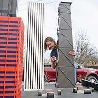 020114       Cayla Nimmo<br /> <br /> Jeremy Devy sets up the model Hancock building on the Chicago portion of the Route 66 themed mini golf course Thursday afternoon. Devy has worked on this project for about a year in his back yard.