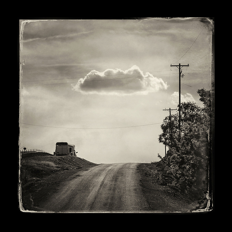 "Charles Blackburn image of a cloud over farm road in Idaho. 5x5"" print."