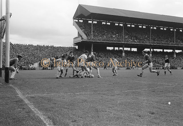 Players challenge for the ball while two players lay on the ground during the All Ireland Minor Gaelic Football Final Sligo v. Cork in Croke Park on the 22nd September 1968. Cork 3-5, Sligo 1-10.