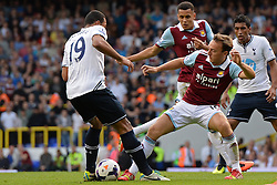 Tottenham Hotspur's Mousa Dembele and West Ham United's Mark Noble compete for the ball - Photo mandatory by-line: Mitchell Gunn/JMP - Tel: Mobile: 07966 386802 06/10/2013 - SPORT - FOOTBALL - White Hart Lane - London - Tottenham Hotspur V West Ham United - Barclays Premiership