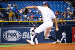 August 22, 2017 - St. Petersburg, Florida, U.S. - WILL VRAGOVIC   |   Times.Tampa Bay Rays shortstop Adeiny Hechavarria (11) watches as starting pitcher Chris Archer (22) winds up to throw in the third inning of the game between the Toronto Blue Jays and the Tampa Bay Rays at Tropicana Field in St. Petersburg, Fla. on Tuesday, Aug. 22, 2017. (Credit Image: © Will Vragovic/Tampa Bay Times via ZUMA Wire)