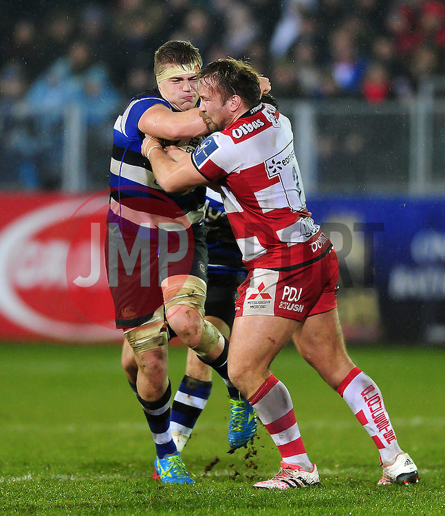 Tom Ellis of Bath Rugby looks to fend Paul Doran-Jones of Gloucester Rugby - Mandatory byline: Patrick Khachfe/JMP - 07966 386802 - 27/01/2017 - RUGBY UNION - The Recreation Ground - Bath, England - Bath Rugby v Gloucester Rugby - Anglo-Welsh Cup.