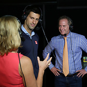 Novak Djokovic visits the ESPN booth with Chris Evert and Patrick McEnroe during the 2015 BNP Paribas Open in Indian Wells, California on Thursday, March 19, 2015.<br /> (Photo by Billie Weiss/BNP Paribas Open)