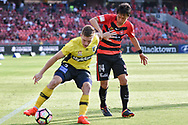 February 12, 2017: Central Coast Mariners Scott GALLOWAY (3) trying to get around Western Sydney Wanderers forward Jumpei (14) at Round 19 of the 2017 Hyundai A-League match, between Western Sydney Wanderers and Central Coast Mariners played at Spotless Stadium in Sydney.
