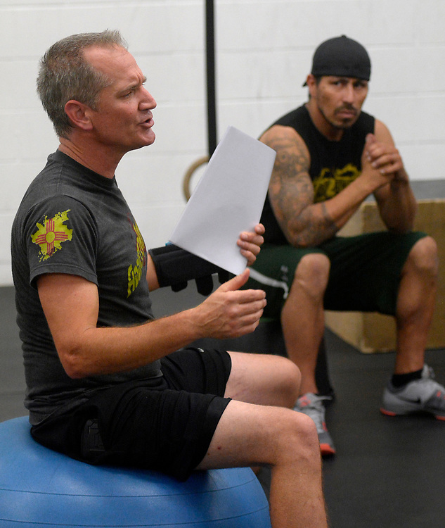 gbs090717e/ASEC -- Counselor Tim Allen, left, facilitates  the Addicts2Athlete fitness/therapy program for recovering addicts on Thursday, September 7, 2017. Johnny Armijo of Albuquerque, right, is in the group.(Greg Sorber/Albuquerque Journal)