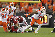 Clemson Tigers defensive tackle Carlos Watkins (94) celebrate a stop on Alabama Crimson Tide running back Bo Scarbrough (9) in the first half of the National Championship game at Raymond James Stadium in Tampa, Monday, January 9, 2017.