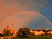 Rainbow after storm  in city neighbourhood<br />