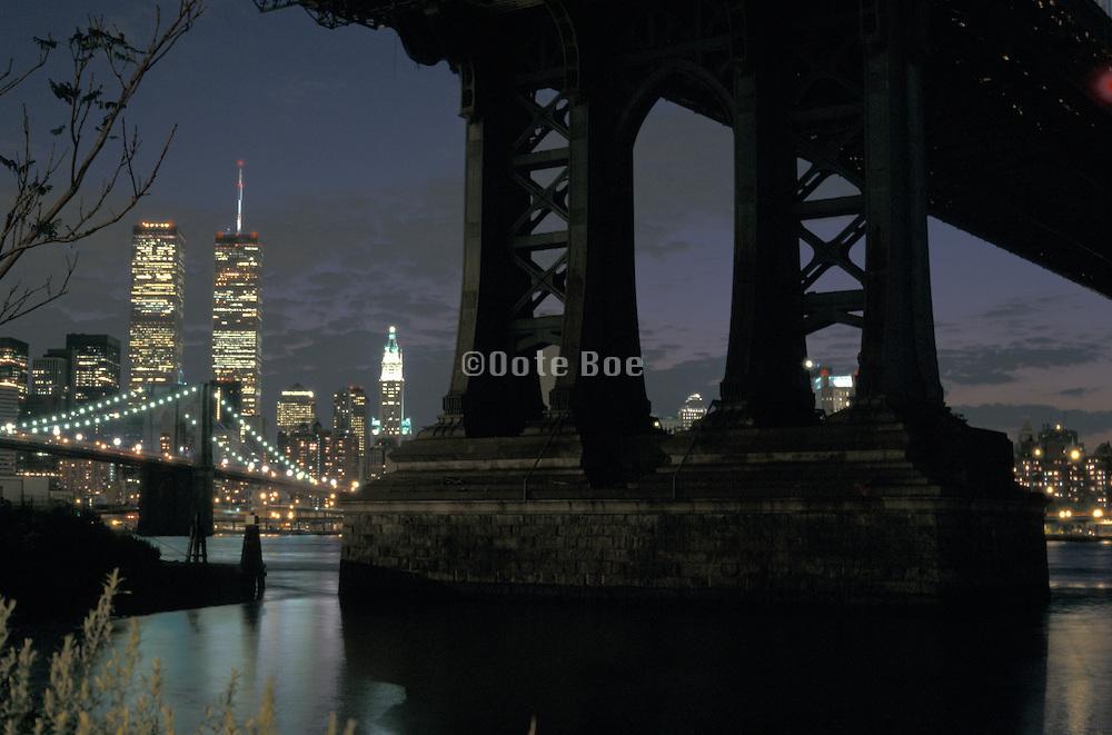 Twin Towers at night under Manhattan Bridge