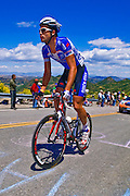 Professional cyclist and spectators at the Amgen Tour of California, Santa Monica Mountains, California